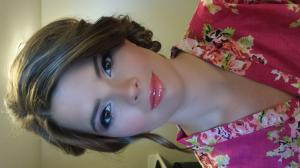 Image of bridesmaid showing off her airbrush makeup and bright shade of lipstick