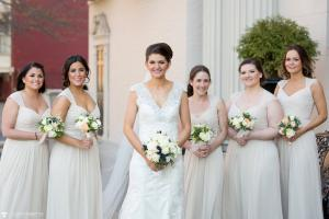 Image of bride with her bridesmaids wearing beige dresses during Spring time in front of Franklin Plaza in Troy New York