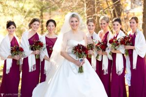 Image of a Fall bride with bridesmaids wearing deep raspberry dresses