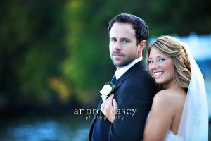 Image of a happy bride embracing her groom in Lake George New York for a September wedding