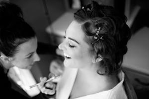 Image of jl beauty inc makeup artist airbrushing happy bride