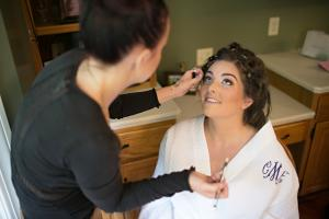 Image of Jessica Lafata applying makeup to bride on her wedding day
