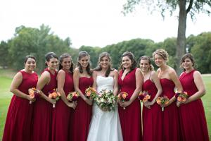 Image of a bridal party with bride posing for professional photo at golf course