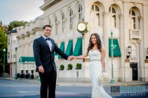 Image of glam bride and her groom in front of Franklin Plaza Ballroom in Troy New York