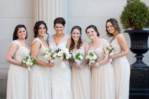 Image of spring bride with her bridesmaids who are wearing beige dresses