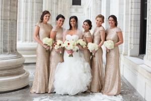 Image of glam bride with her bridesmaids outside for winter wedding bridesmaids are wearing rose gold sequin dresses and all are holding bouquets