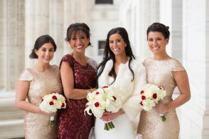 Image of Winter bride with her two bridesmaids wearing rose gold sequin dresses and her mother who is wearing a deep cranberry sequin dress