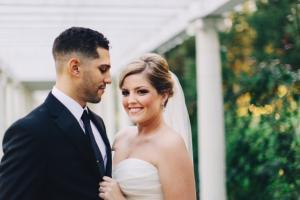 Image of gorgeous bride and groom outside embracing one another